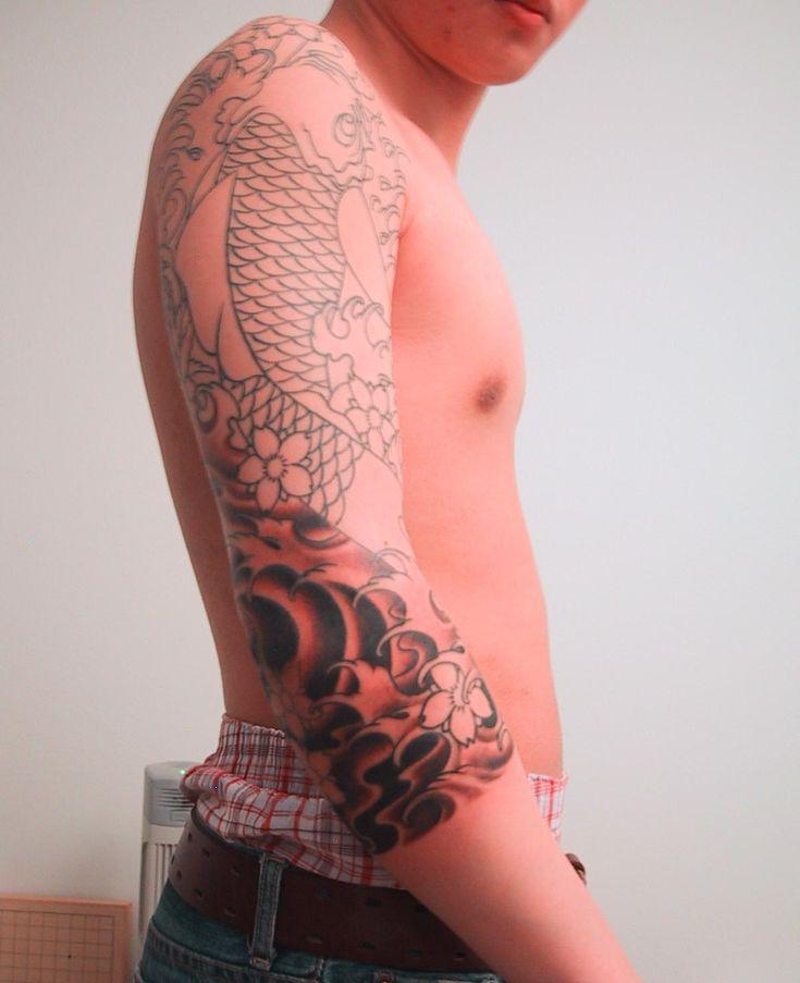 koi tattoo wrapped around the elbow | Dragon Sleeve Tattoos – Designs and Ideas