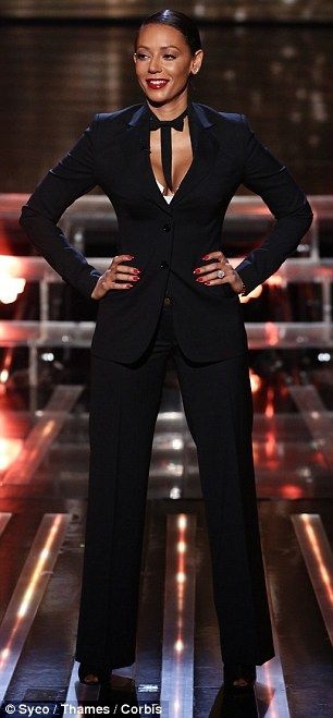 Ladies in black: Mel B went for a cleavage plunging trouser suit, whereas Cheryl opted for...