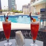 Singapore Slings by the pool at the Hilton Singapore Hotel