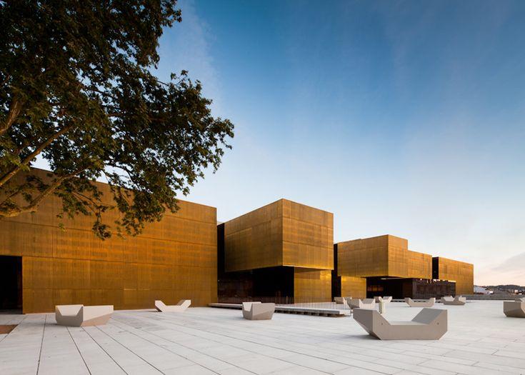 Jose de Guimarães International Arts Centre with golden brass walls in Portugal by Pitagoras Arquitectos.