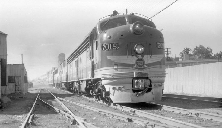 "aryburn-trains:  "" MP train, engine number 7018 + additional diesel units, engine type EMD E8  Train #3, Colorado Eagle. Photographed: leaving Denver, Colo., July 4, 1956.  """
