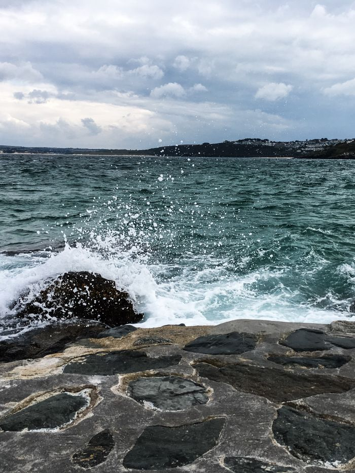 Waves crashing against the rocks St Ives Cornwall on a cold autumn day