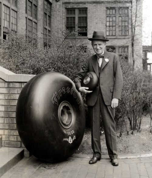 Harvey Firestone with he biggest and smallest tires his comapny made at the time