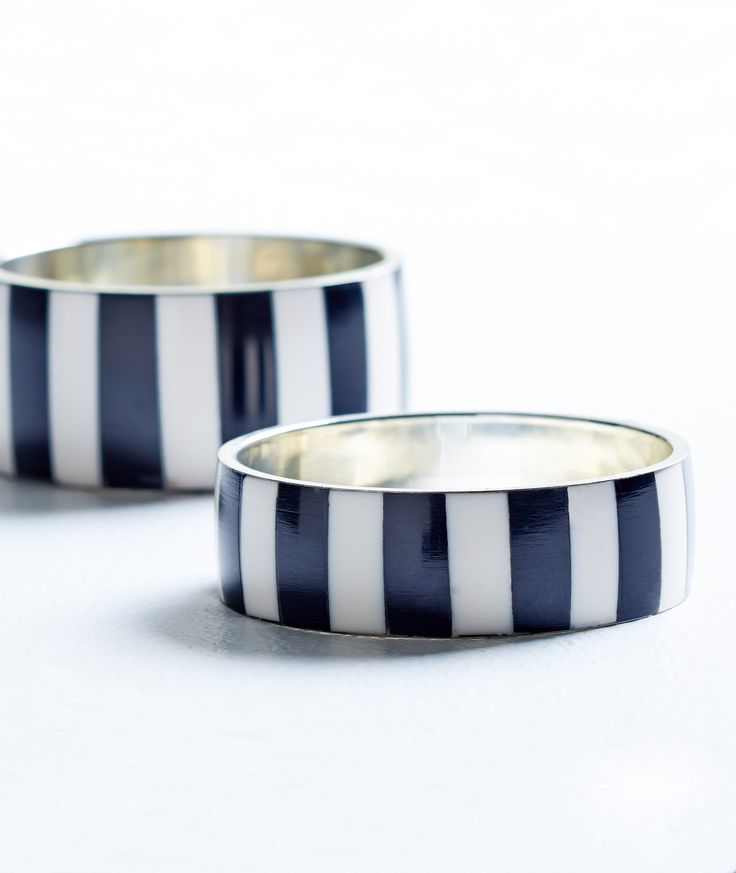 Polished black and white never goes out of style. Team this striped stacker cuff set with a dark fashion top for a fashionable weekend look.