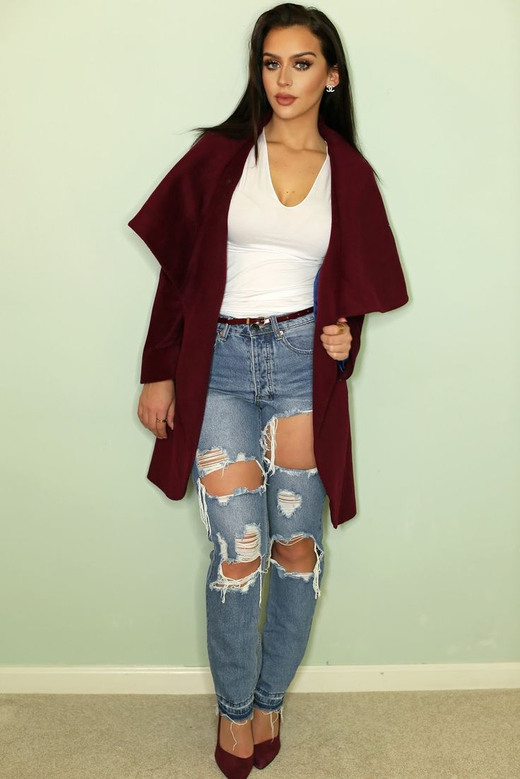 cranberry coat with torn jeans and a plain white T