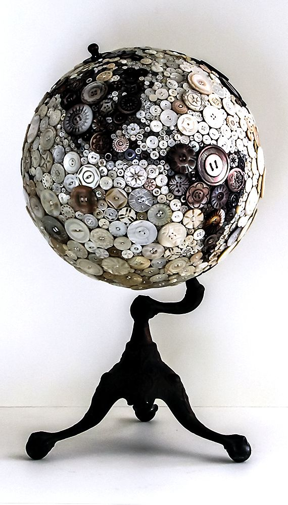 """Robin Ayres – button globe. All the buttons are carved mother of pearl and abalone. The buttons are all sewn on""""."""