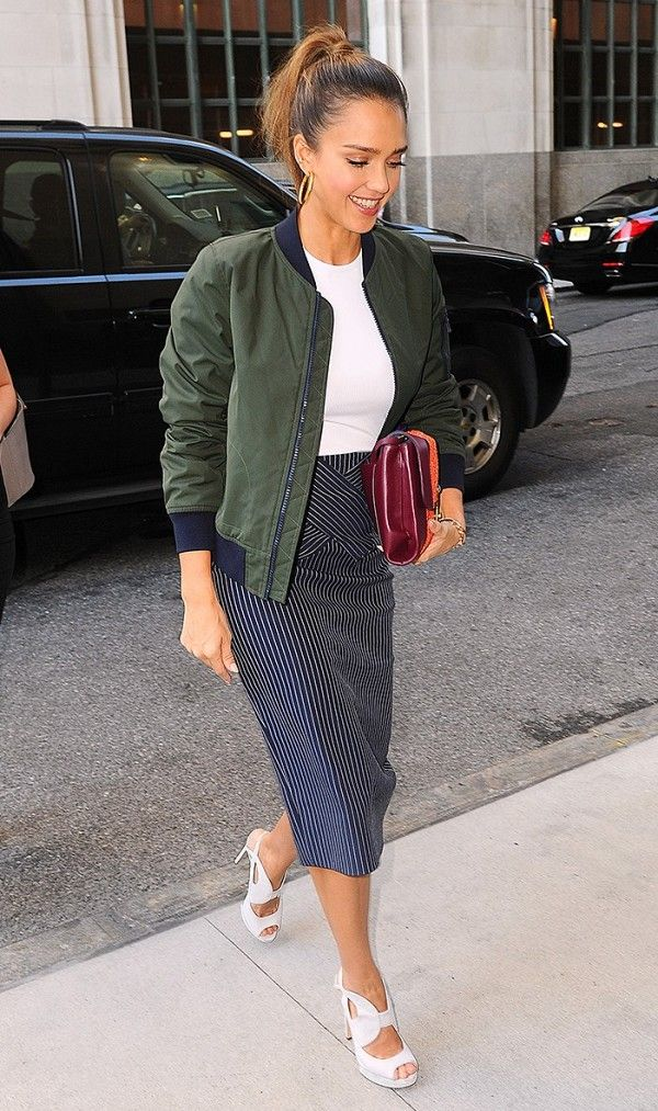Try tossing a bomber jacket over a pencil skirt and basic tee for a sporty chic look