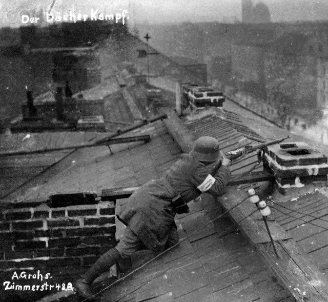 German Revolution 1918/1919: A government soldier (white armband) is pictured in combat position in Berlin, Germany, during the street fights. Date unknown. Photo: Berliner Verlag/Archiv