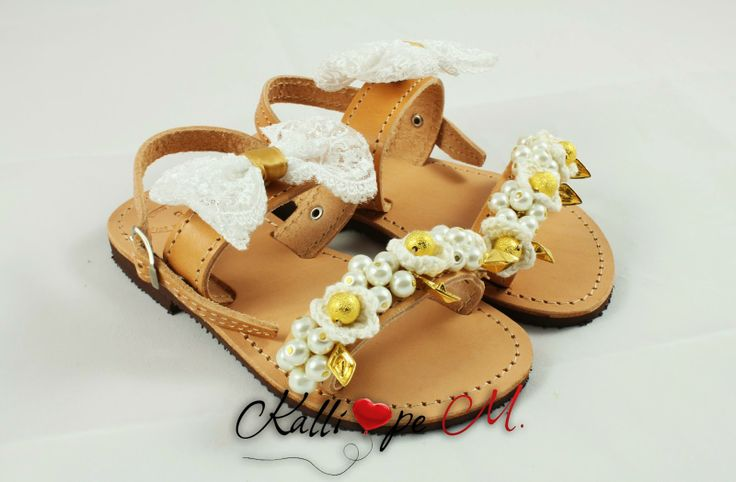 Handmade leather sandals decorated with handmade crochet flowers, pearls, metalic materials, and a lace bow. #cute #sandals #summer #children #girls #baptism