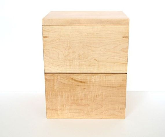 Simple and elegant wooden urn with removable tray. Made of flamed maple with birch and black walnut accents.