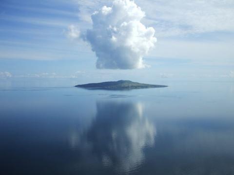 Island floating in the clouds. Erub (Darnley) Island | Torres Strait Island Regional Council