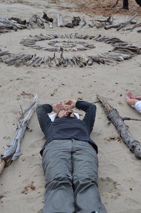 FACEBOOK 16 Aug Linette Swart. Lying among the art pieces at Site_Specific #LandArtBiennale. #LandArt. #Plett