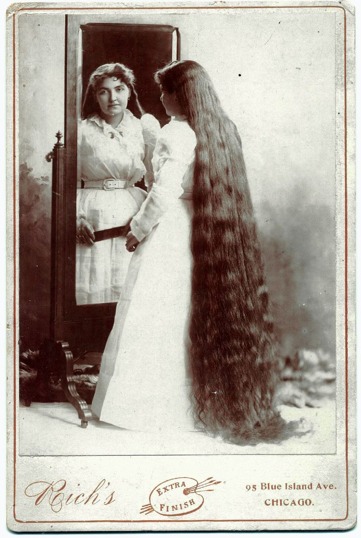 """The back of this cabinet card is labeled in pencil, """"Miss Taylor, hair 6 ft 6 inches long."""""""