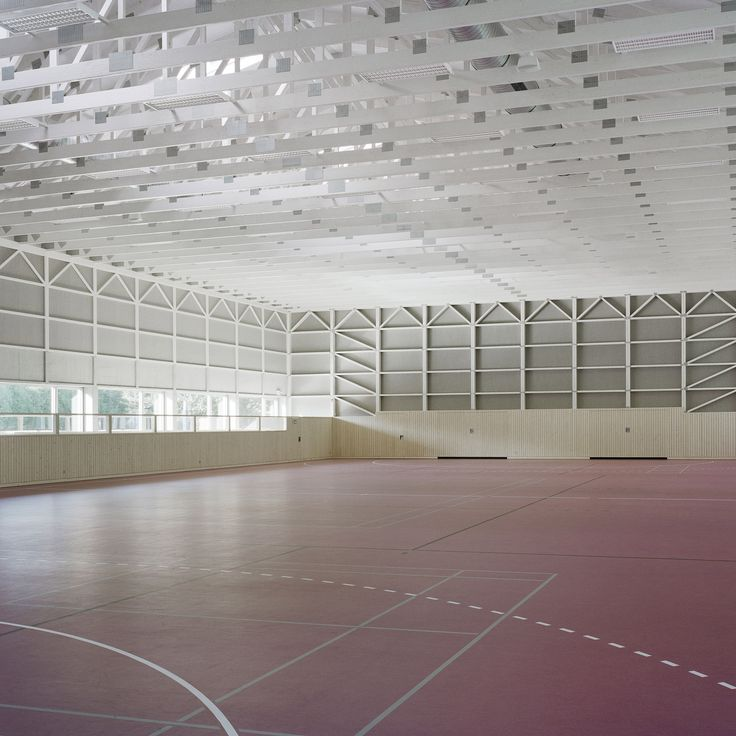 Architect Florian Fischer used prefabricated timber building technology to realise this shed-like sports hall in Austria's Tyrol region.