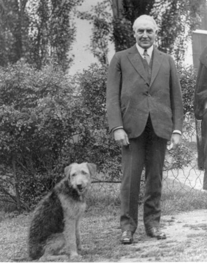 President Warren Harding didn't seem to mind at all that his dog had interrupted a White House photo shoot.