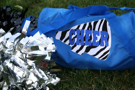 Bling Cheer Bag with glitter CHEER and zebra megaphone. This bag is the perfect size for poms, water bottle and sweatshirt. Made of 50%