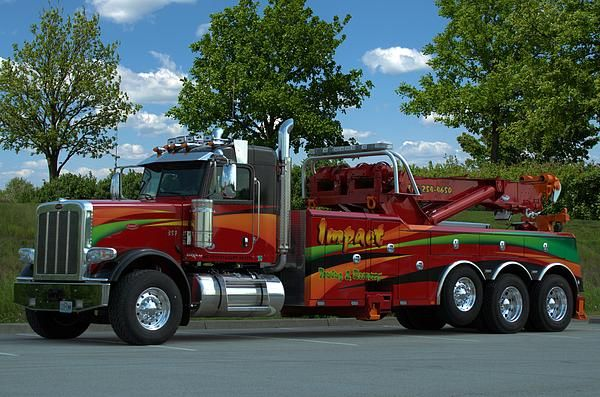 :  This great looking Impact Towing and Recovery Big Rig Tow Truck has been to several car/truck shows in the Kansas City area.