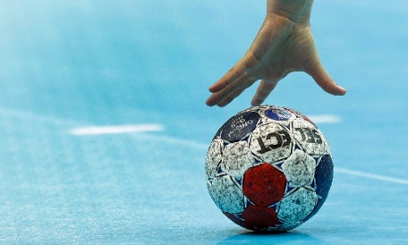 Hand. Ball. Sweden's goalkeeper Cecilia Grubbstrom grabs a ball during their women's handball preliminary match against France. Photograph: Matthias Schrader/AP