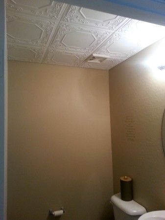 CEILING TILES! Don't waste time and money on removing popcorn ceiling, just install ceiling tiles over it! Video Tutorial on this site. All you need is Ceiling Tile, water based paint in color of your choice, liquid nails, and craft scissors!