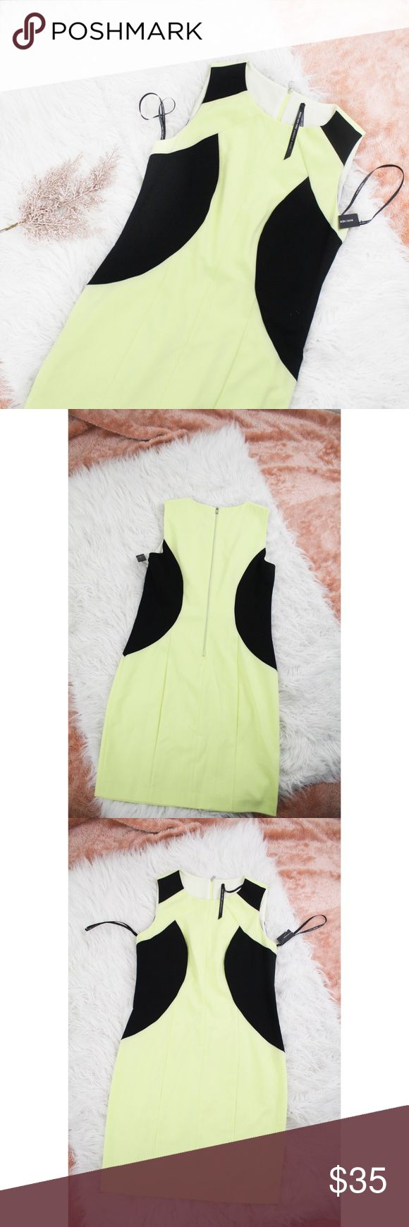 "NWT Andrew Marc Yellow Colorblock Sheath Dress Lovely, Andrew Mark dress in the colors neon yellow and black. Sleeveless.  Size: 8 Material: 63% polyester, 33% rayon, 4% spandex Measurements: Bust "" 34"", Length ""36 ""  **Feel free to message me asking any questions.  * All items are measured laying flat then doubled  * Comes from a smoke-free home Andrew Marc Dresses"
