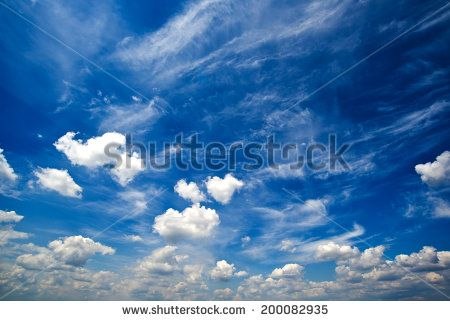 Blue daylight summer sky with fluffy white clouds as nature background. - stock photo