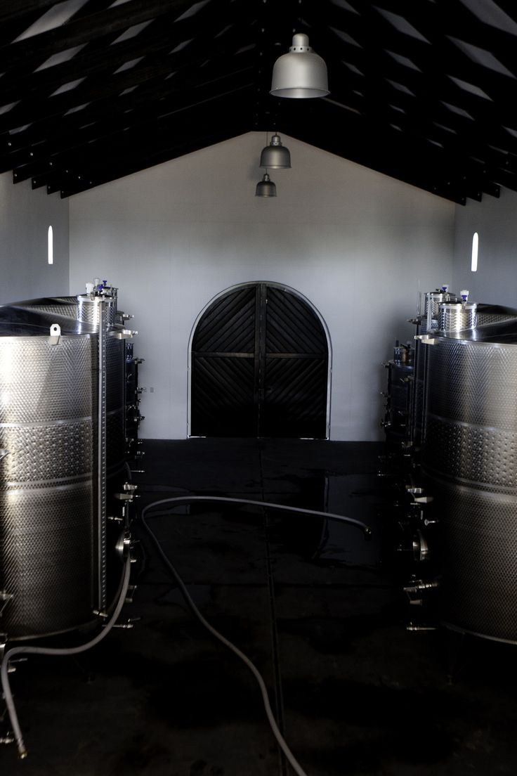 From the tasting room gallery - view of the cellar door with pipes and tanks