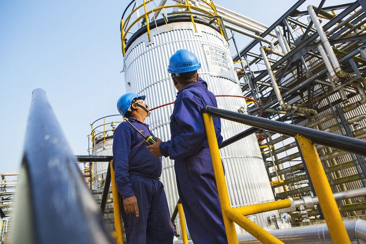 Bhoja Moolya (left) and Krishnamorthy (right), both technicians, carry out a routine safety inspection. The Mangalore site has been in operation since 1996 and is the largest BASF production site in India and South Asia. It is involved in the production of performance chemicals (leather and textile chemicals), dispersions, paper chemicals, automotive & coil coatings and construction chemicals and targets India's southern markets. Print free of charge. Copyright by BASF.