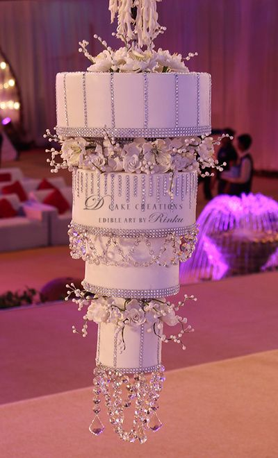 unique upside down cake with crystals and feathers, chandelier cake, unique idea                                                                                                                                                                                 More