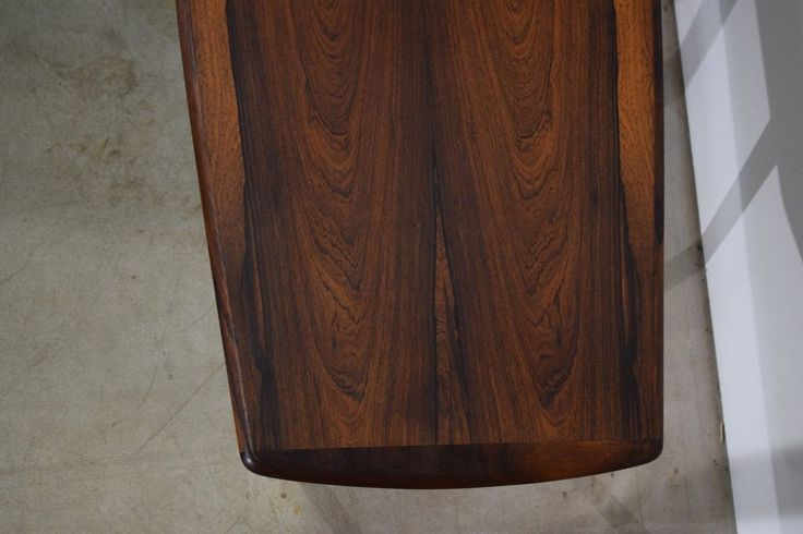 Rectangular Danish mid century rosewood coffee table by Ingvard Jensen. Produced by Odense Møbelfabrik. Rosewood veneer and stained wooden legs. 160 x 65 x 52 c