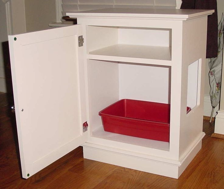 Cat Litter Box / Cabinet w/Shelf except there should be air holes so kitty doesn't get woozy from the ammonia or something. :)