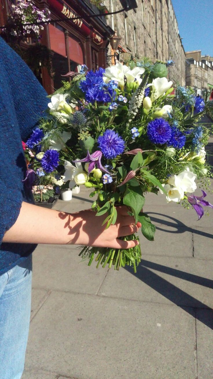 Very wild bridal bouquet , with a picked from a garden feeling using seasonal blooms such as Cornflower, Clematis,Freesia,Forget me nots, Nigella and Veronica. #rustic #Edinburgh #florist #Scottish #wedding