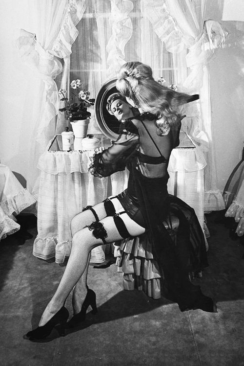 """sharontates: """" A model wears lingerie, New York, 1948. Photo by Peter Stackpole """""""