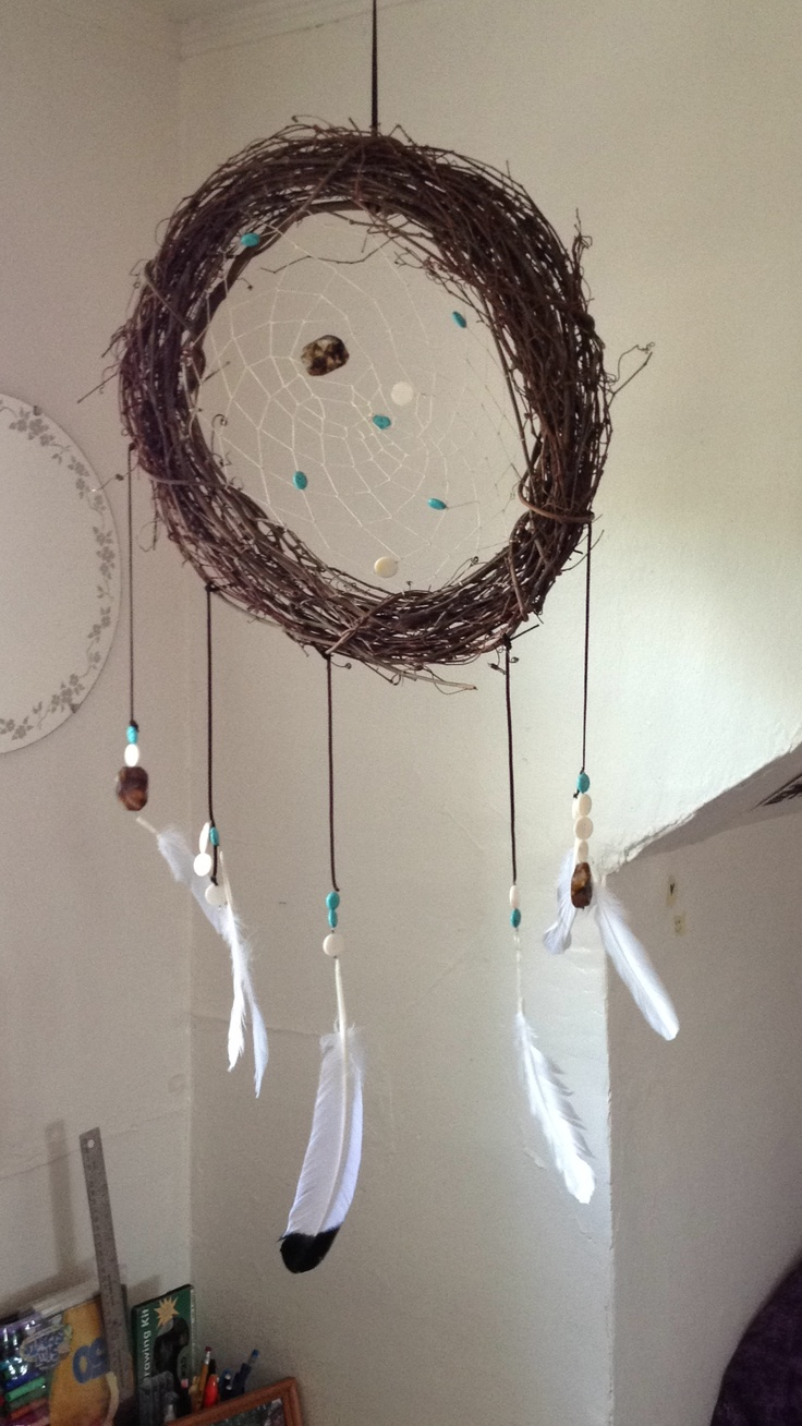 Home-made Dreamcatcher :) all supplies from Jo Ann; learned how to do it from a Youtube video; inexpensive and easy to personalize :)