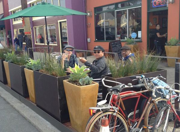 parklet in long beach. spring street parklets are on the way. A parklet is the temporary use of curbside parking space for outdoor landscape and seating. A deck is constructed and raised in the parking space at the same elevation as the adjoining sidewalk.