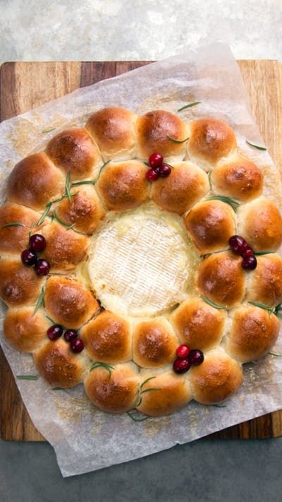Baked brie is even better when surrounded by hot steamy buns stuffed with prosciutto and cranberries.
