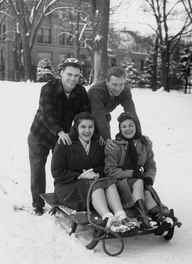 The 1950s Wisconsin woman even wore her oxfords out in the snow! And she wouldn't be caught dead without lipstick, even while sledding on Bascom Hill. Source: UW-Madison Archives. Image #S00127