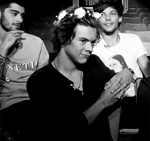 [GIF] He's so adorable in his flower crown. I can't. He looks like a cupcake. A bossy one at that.