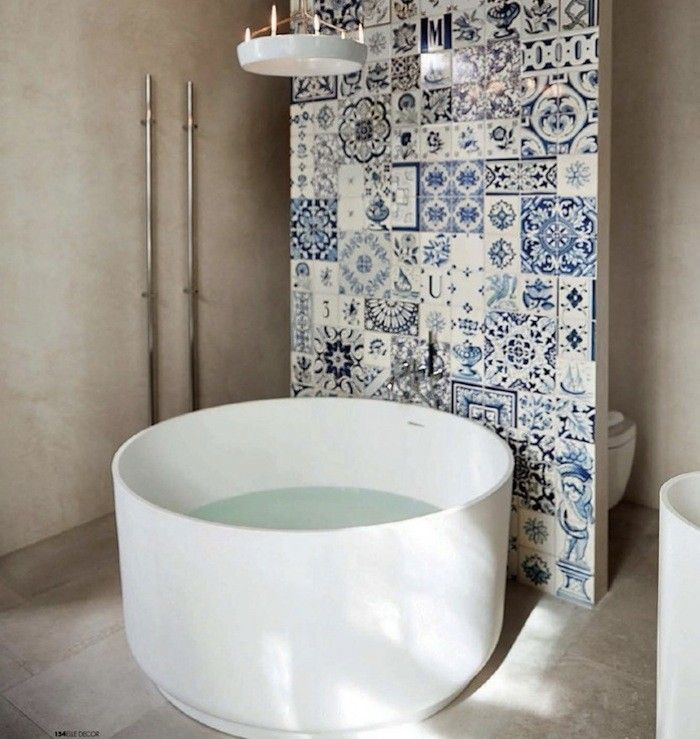 A Round White Porcelain Tub featured in Elle Decor Italia I Remodelista