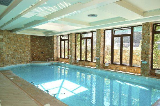 Pool designs indoor pools and swimming pool cost on pinterest for Indoor swimming pool cost