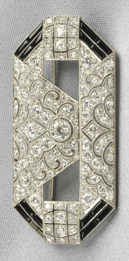 Art Deco platinum, onyx, and diamond brooch. Set with old European-, single-, and rose-cut diamonds, shaped black onyx highlights, millegrain accents, lg. 2 1/8 in. #ArtDeco