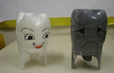 What a cute idea. No instructions but they look like they are made from 2 liter soda bottles and maybe spray painted white and gray and cut to resemble a tooth. Clever!
