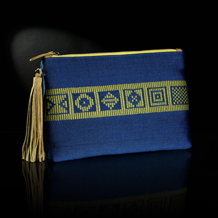 The handmade woven envelope adorns patterns from Greek history and tradition. The background is in royal blue color and the embroidery in light green color.