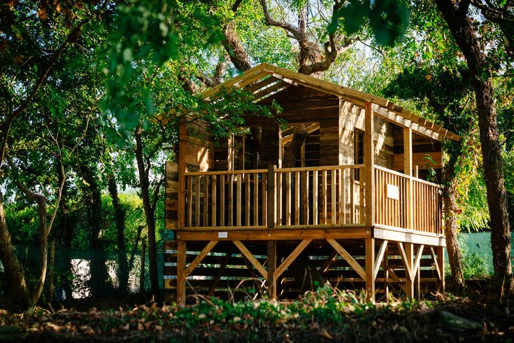 Pretty wooden playhouse in Kids Rustic with Playhouses next to Playset alongside Outdoor Playhouse and Natural Landscape