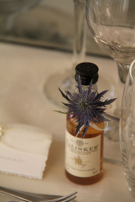 miniature bottles of whisky are always a favourite as a wedding favour - nice touch with the sea holly.