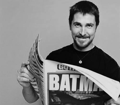 Bruce Wayne (Christian Bale) reads.