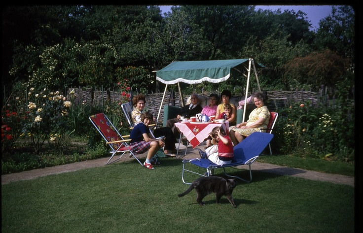 Spending our summer holidays at our grandpartents' house in Beckenham. Fond memories of the rose garden and the swing chair.  We rocked that chair!!!  And there's Wimpy! She (or was it a he?) lived to be over 25. Every single year when we came over, we thought she wouldn't be there anymore. But she was. At least for a very long time. A remarkable cat.