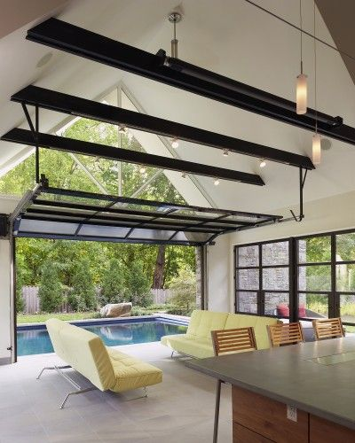 Glass garage doors for opening out to the screen porch is an idea we like.  Not black, but galvanized steel.