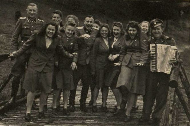 in the shadow of horror, Auschwitz -- German females relax.