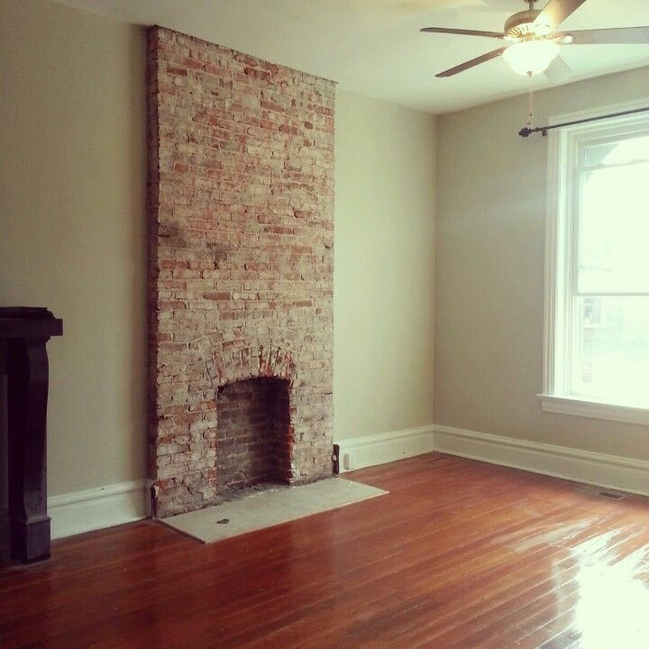 Exposed brick fireplace