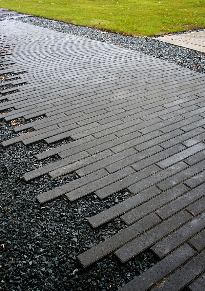 torn edge walkway...only use bigger pavers...to transition from walk to outer gravel area with no edging